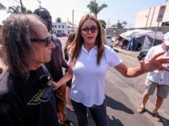 Caitlyn Jenner, centre, on the campaign trail at Venice Beach (Ringo HW Chiu/AP)