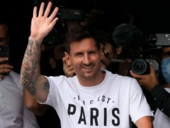 Lionel Messi waves after arriving at Le Bourget airport, north of Paris (Francois Mori/AP)