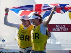Great Britain's Hannah Mills and Eilidh McIntyre celebrate after winning the women's 470 race (AP Photo/Gregorio Borgia)