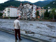 Flood waters sweep by in Bozkurt town, Kastamonu province (IHA/AP)