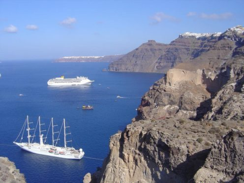 The cliffs of the volcanic island of Santorini, which show the layers of deposits from past volcanic eruptions (Dr Ralf Gertisser/Keele University/PA)