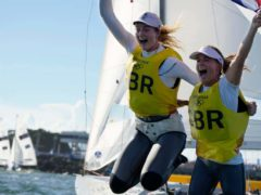Great Britain's Hannah Mills and Eilidh McIntyre celebrate after the women's 470 race (AP Photo/Gregorio Borgia)