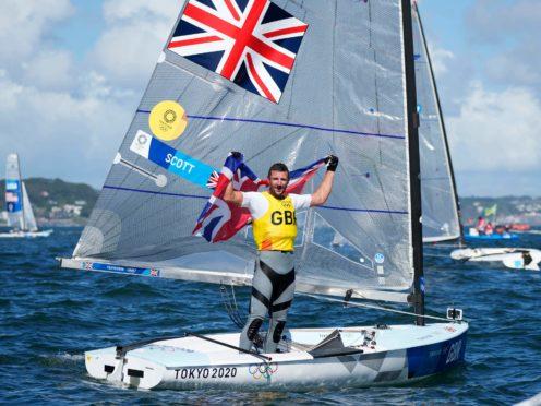 Giles Scott celebrates after winning gold (Bernat Armangue/AP)