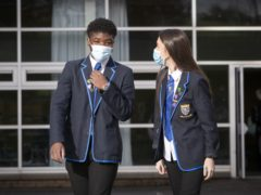 John Swinney said face coverings will still be required in secondary schools in Scotland – even if Covid vaccinations are extended to 16 and 17-year-olds (PA)