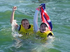 Hannah Mills and Eilidh McIntyre celebrate their golds in the sea (Gregorio Borgia/AP)