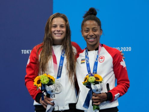 Jennifer Abel and Melissa Citrini-Beaulieu of Canada with the silver medals they won in the women's synchronised 3m springboard final (Dmitri Lovetsky/AP)