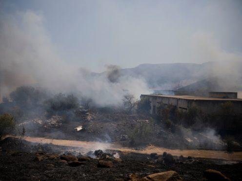Fields burn following a hit by a rocket fired from Lebanon into Israeli territory, near the northern Israeli town of Kiryat Shmona (AP)