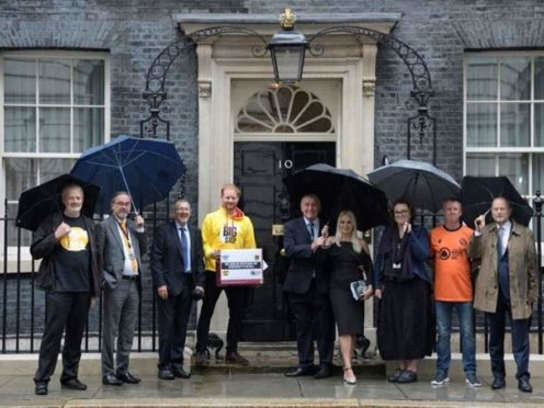 Campaigners, including Peter Shilton and his wife Steph (centre right) hand in a petition to Downing Street (Gambling with Lives/The Big Step)