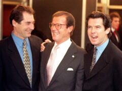 James Bond actors Timothy Dalton, left, Sir Roger Moore, centre, and Pierce Brosnan pictured in 1996 (Fiona Hanson/PA)