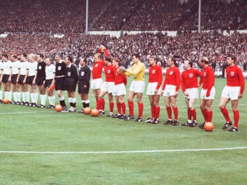 The England and West Germany teams line up on the pitch at Wembley before the 1966 World Cup final (PA)