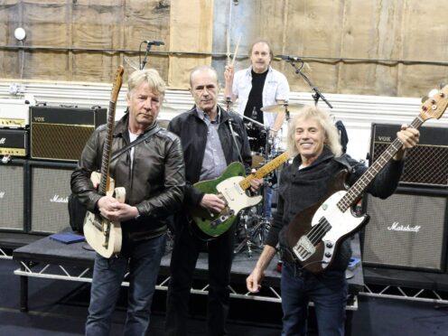 The original members of Status Quo, front from left, Rick Parfitt, Francis Rossi, Alan Lancaster and John Coghlan, rear (Steve Parsons/PA)