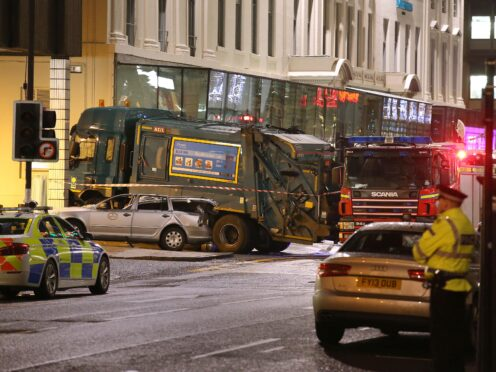 The scene in Glasgow's George Square after an out-of-control bin lorry careered through streets packed with Christmas shoppers killing six people