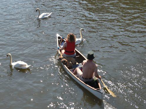 People canoe along the River Bure in Wroxham on the Norfolk Broads (Joe Giddens/PA)