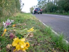 Floral tributes on the B4031 outside RAF Croughton, in Northamptonshire, where Harry Dunn, 19, died when his motorbike was involved in a head-on collision in August.