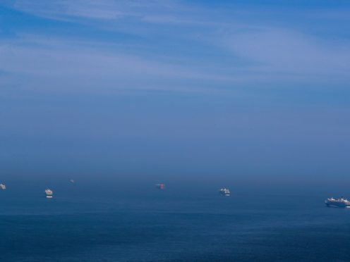 Cruise liners and cargo ships (Steve Parsons/PA)