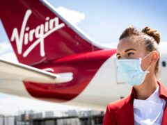 Virgin Atlantic has announced it will not hire new cabin crew or pilots who are not fully vaccinated against coronavirus (Matt Alexander/PA)