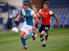 Blackburn defender Hayden Carter, left, is back in contention after suspension (Morgan Harlow/PA)