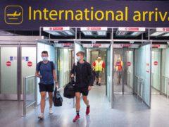 Passengers arrive at Gatwick Airport (Dominic Lipinski/PA)
