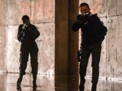 Daniel Craig playing James Bond and Lashana Lynch playing Nomi (Nicola Dove/Danjaq, LLC/MGM)