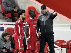 Liverpool manager Jurgen Klopp (right) will be without Sadio Mane and Mohamed Salah in January (Peter Powell/PA)