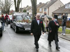 The funeral procession of Olly Stephens slows at All Hallows Road, Reading to receive floral tributes, before making its way to Reading Crematorium (Steve Parsons/PA)
