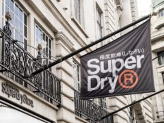 Superdry has reported shrinking losses and said sales are recovering well (Ian West/PA)