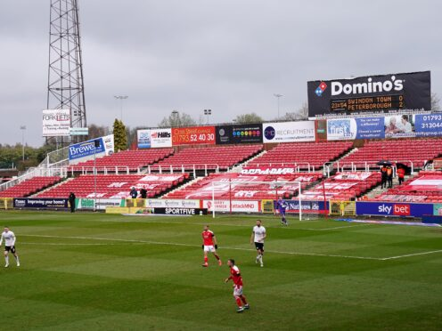 Swindon are back in action at The County Ground against Colchester (Tess Derry/PA)