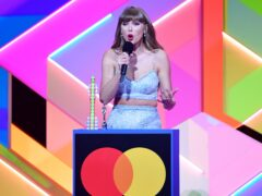 Taylor Swift accepts the Global Icon award during the Brit Awards 2021 (Ian West/PA)