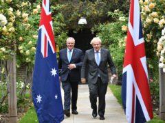 Prime Minister Boris Johnson (right) and Australian Prime Minister Scott Morrison announced the creation of the Aukus pact alongside US President Joe Biden (Dominic Lipinski/PA)