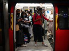 Passengers on a Jubilee line Tube (Yui Mok/PA)