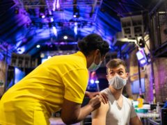 Nathaniel McVeigh receives a dose the Pfizer/BioNTech Covid-19 vaccine at Heaven nightclub in central London in August 2021 (Dominic Lipinski/PA)