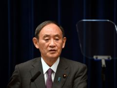 Japan's Prime Minister Yoshihide Suga will not run for the leadership of the governing party in an indication he will step down as the country's leader at the end of this month (Kazuhiro Nogi/Pool/AP)