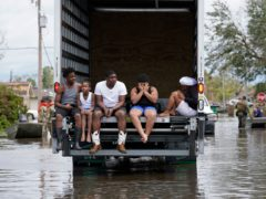 People are evacuated from floodwaters in the aftermath of Hurricane Ida in the US state of Louisiana (Gerald Herbert/AP)