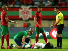 Republic of Ireland defender Dara O'Shea receives treatment on the pitch in Portugal (Isabel Infantes/PA)