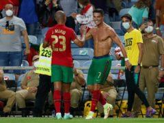 Portugal's Cristiano Ronaldo, right, celebrates (Armando Franca/AP)