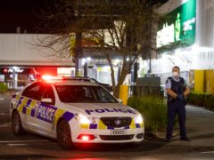 Police outside the supermarket in Auckland, New Zealand, where a violent extremist stabbed seven shoppers (Brett Phibbs/AP)