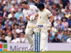 Pitch invader Daniel Jarvis, left, collides with England batsman Jonny Bairstow (Adam Davy/PA)