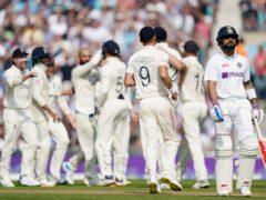 England celebrate taking the wicket of Virat Kohli, right (Adam Davy/PA)