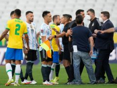 The match in Sao Paolo was suspended after officials came on to the pitch (Andre Penner/AP).
