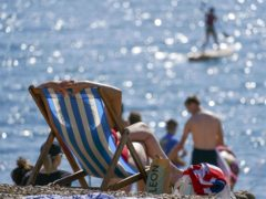 The Post Office handled record amounts of cash as holidaymakers embarked on UK-based staycations in August (Steve Parsons/PA)