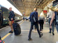 Train passengers at Bristol Temple Meads (Ben Birchall/PA)