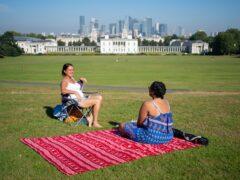 People enjoy the sun in Greenwich Park, London (Dominic Lipinski/PA)