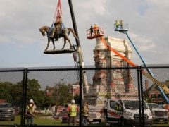 Crews remove one of the country's largest remaining monuments to the Confederacy, a towering statue of Confederate General Robert E. Lee on Monument Avenue in Richmond, Virginia (Steve Helber/AP)