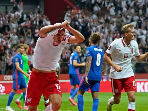 Damian Szymanski celebrates equalising for Poland (Czarek Sokolowski/AP)