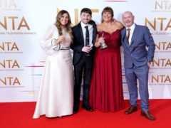 Sophie Sandiford, Pete Sandiford, Julie Malone and Tom Malone in the press room after winning the factual award for Gogglebox (Ian West/PA)