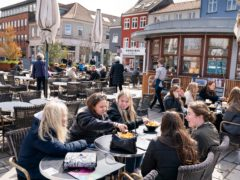People sit outside a restaurant for outdoor service in Roskilde Denmark (Claus Bech/Ritzau Scanpix via AP, File)