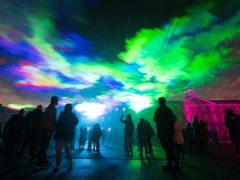 People view 'Borealis' a laser light art installation by Dan Acher (Dominic Lipinski/PA)