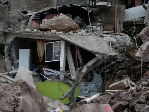 Boulders and debris that plunged from a mountainside rest atop homes in Tlalnepantla, on the outskirts of Mexico City (AP Photo/Ginnette Riquelme)