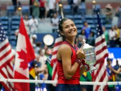 Emma Raducanu holds the US Open trophy (Elise Amendola/AP)