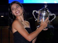 Emma Raducanu poses with the US Open trophy (Elise Amendola/AP)